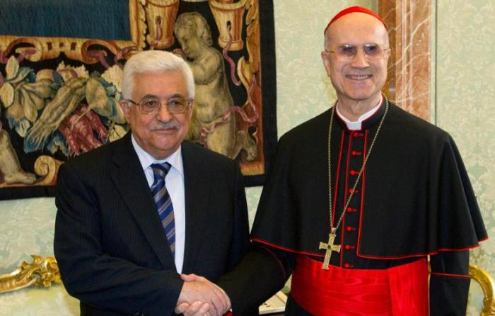 Palestinian president Mahmoud Abbas and Vatican Secretary of State Cardinal Tarcisio Bertone shake hands at the Vatican Monday 17 December 2012.The Palestinian president, Mahmoud Abbas has met with Pope Benedict XVI to thank him for supporting the recent U.N. resolution recognizing a Palestinian state. http://english.al-akhbar.com/node/14412